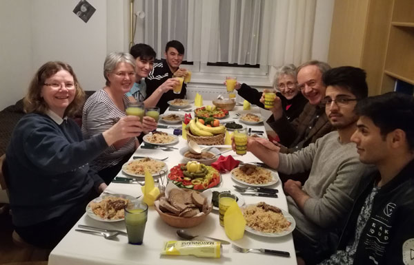 Sisters Jean Greenwald and Helen Plum live in an apartment building in Eggenburg, Austria. They share meals regularly with their neighbors, who are locals and refugees.