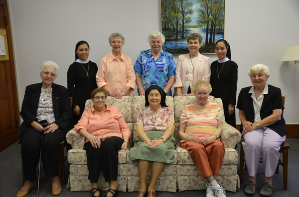 Two visiting Vietnamese sisters were happy to take a photo with their teachers in St. Louis.