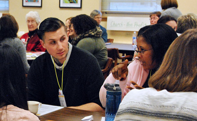 Participants met in a debriefing session following four simulated days that served to show what maneuvering society is like for immigrants. The event was held at Notre Dame of Elm Grove, Wisconsin.