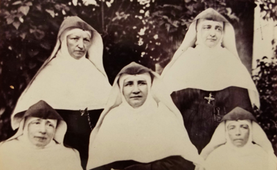 Mother Caroline Friess (center)