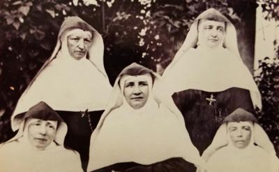 Mother Caroline Friess (center)