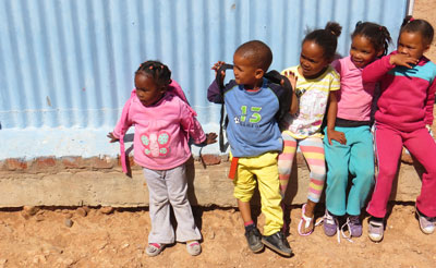 Young children anxiously waiting for school day to begin.