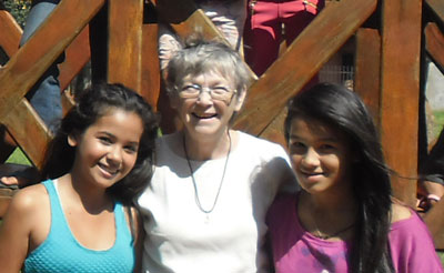 Sister Leetta Hammack works with children at Tupasy Roga, an after-school program for children in Paraguay.