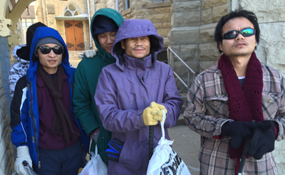 Associate Kate Fontanazza ESL students learning to dress in layers.