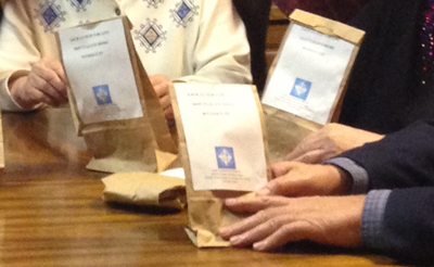 Sisters and associates in Coolville, Ohio, assemble prayer sacks for the Catholic youth in the area.