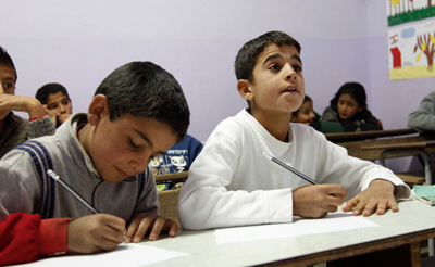 Muhanad and Ahmad, both aged 11, from Syria, in school in Lebanon's Bekaa Valley, close to the border with Syria.