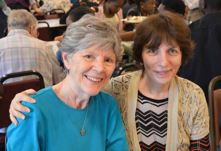 Sister Mary Bryan Owens catches up with a friend at the International Institute Luncheon in St. Louis.