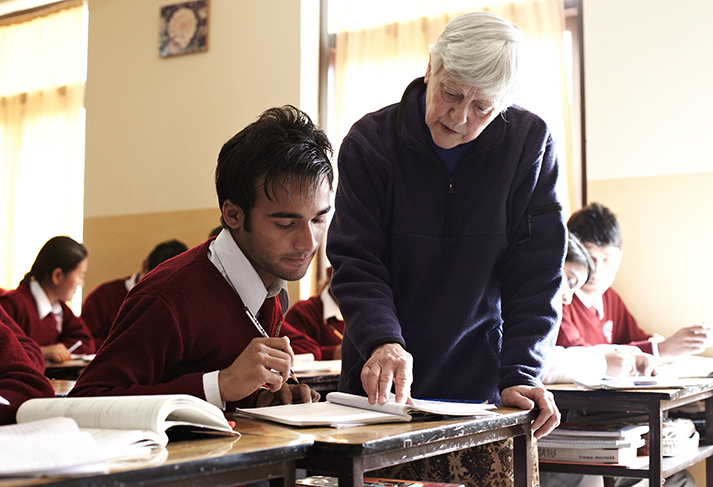 Sister Barbara Soete teaches a student in Bandipur, Nepal.