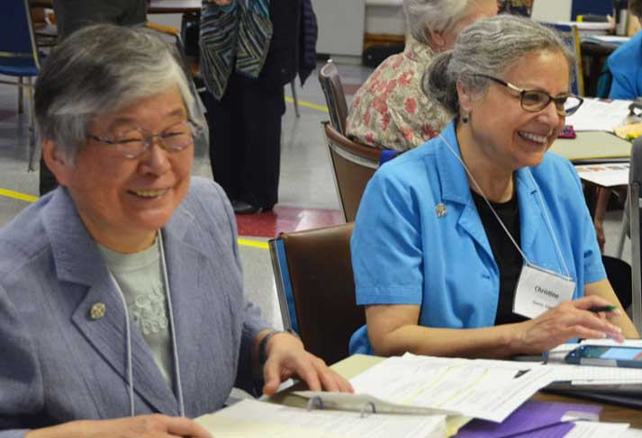 Sisters Ruth Mori and Christine Garcia chat during the Assembly of the Whole meeting in St. Louis.