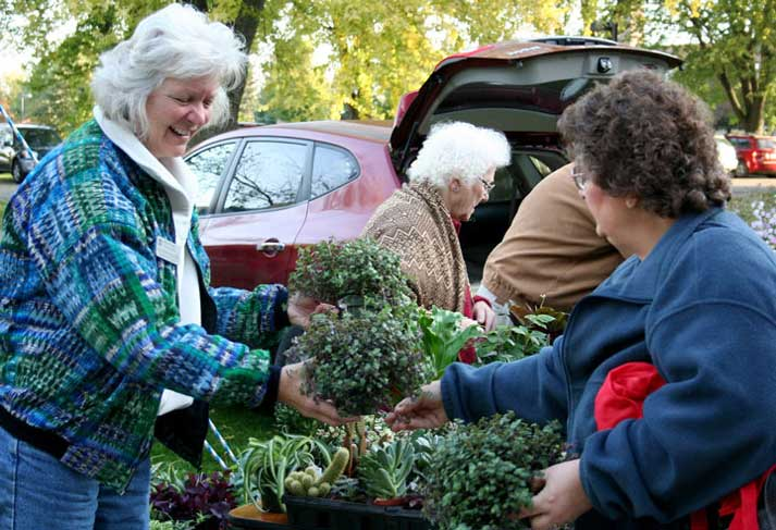 The crowds came early and stayed throughout the day for the 40th annual Craft Fair and Garage Sale at Our Lady of Good Counsel in Mankato, Minn., Oct. 10, 2015. Provincial Councilor Anne Marie Reha was there with her parents selling plants.