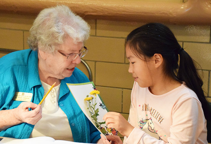 Sister Helen Robeck tutoring Miya, a fourth grader, at Good Counsel Learning Center in Mankato, Minnesota.