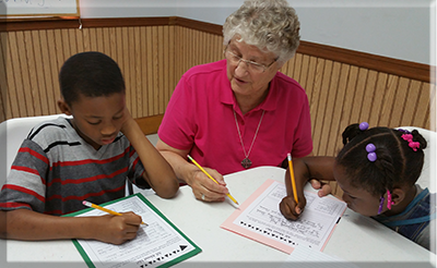 Sister Sylvia Hecht, SSND, with summer students
