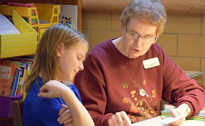Sister Rita Ann Kipka tutors Xavier Lauwagie, a fourth grader, at Good Counsel Learning Center in Mankato, Minnesota.
