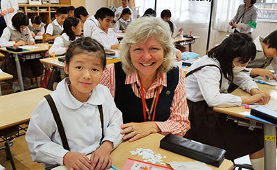 Sister Anna Marie Reha is pictured with a student in her classroom at Notre Dame Elementary School in Kyoto, Japan.