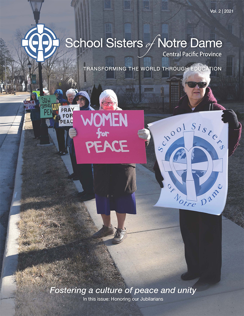 The SSND Newsletter Vol. 2 2021's cover shows sisters stand in solidarity with high school students during a national school walkout calling for more action against gun violence.