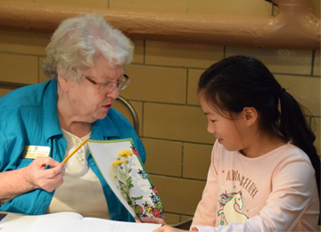 Sister Helen Robeck tutors Miya Lin, a fourth grader, at the Our Lady of Good Counsel Learning Center in Mankato, Minnesota.