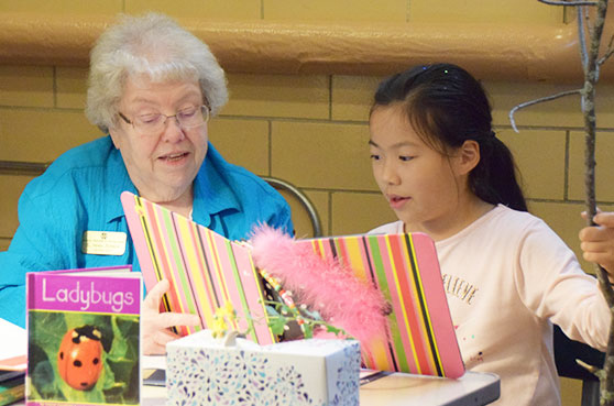 Sister Helen Robeck turtors Miya a fourth grader after school at Our Lady of Good Counsel Learning Center in Mankato, Minnesota.