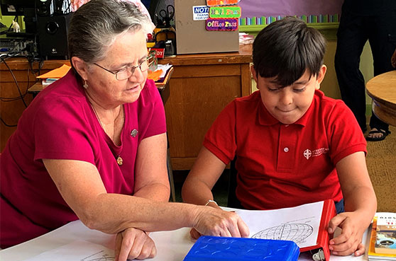 Rising Star in Milwaukee helps students through tutoring. Sister Sylvia Hecht tutors a student to at Notre Dame Middle School.
