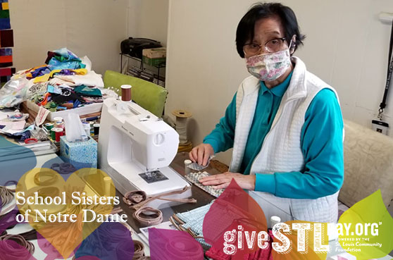 Sister Regina Kabayama poses for a photo in the Liturgical Fabric Arts Department at Sancta Maria in Ripa in St. Louis. The image contains the Give STL Day logo, School Sisters of Notre Dame and boardered by Jubilee 2021 logo image.