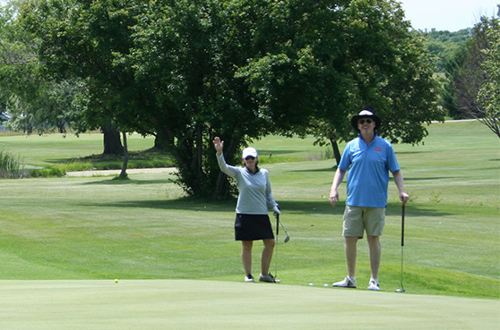 Guests enjoying a round of golf at our annual Golf Tournament and Card Party held at Daytona Golf Course in Dayton, MN