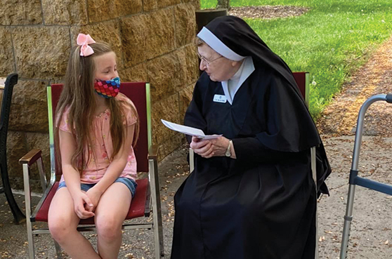 3rd grade pen pals from Loyola Catholic School arrive at Our Lady of Good Counsel to visit with their pen pals. The photo is used for NoFest Octoberfest in 2021.