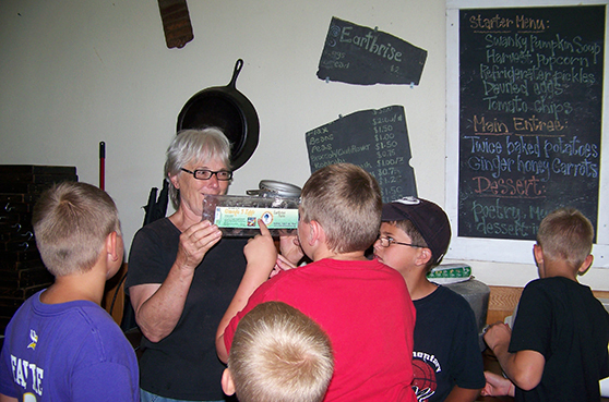 2019 NoFest Octoberfest Event Slider features Sister Annette Fernholz of Earthrise Farms as she discusses eggs with a group of students.