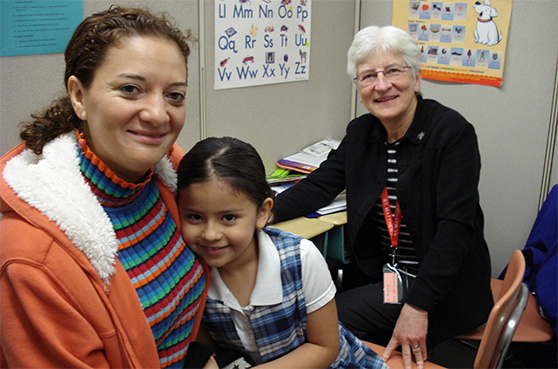 2019 NoFest Octoberfest Event Slider. Features Sister Audrey Lindenfelser works with a mother and child at a learning center.