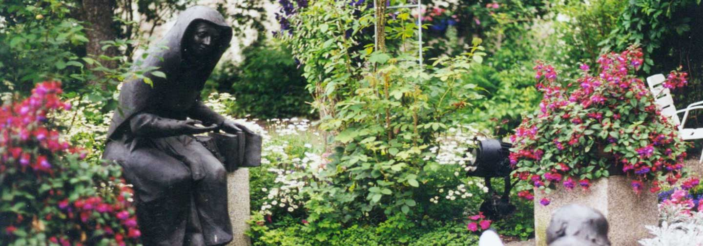 A statue of Blessed Theresa in a garden in Germany