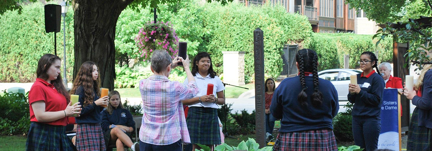 Notre Dame of Elm Grove, gathered around the International Peace Pole on September 21, 2019 with sisters and students of Notre Dame of Milwaukee to pray for peace.