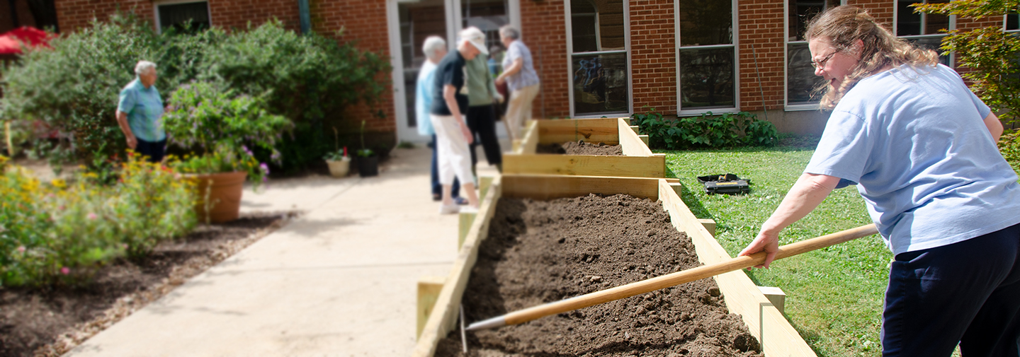 Sister Jean Greenwald tends plans at the Caroline Garden located at Sancta Maria in Ripa, St. Louis.