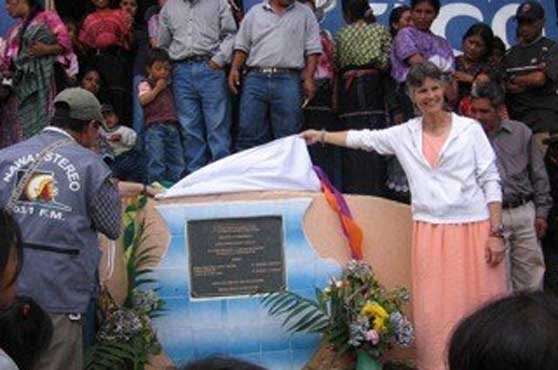 Associate Dianne Henke unveils a plaque commemorating a new water project in Guatemala. She is a co-founder of Global Partners, Running Waters, Inc., a ministry of School Sisters of Notre Dame Central Pacific Province.