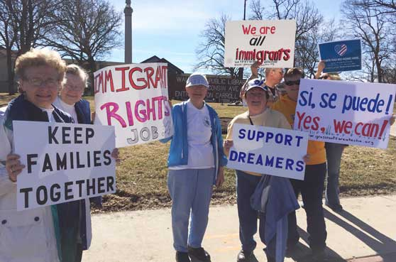 Sisters protest for comprehensive immigration reform to protect Dreamers and those affected by DACA.