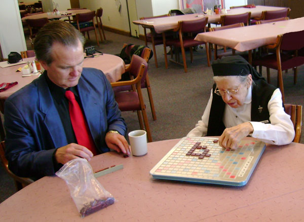 Dr. Snowdon playing Scrabble with sisters in Elm Grove, Wisconsin. Photo taken March 7, 2007