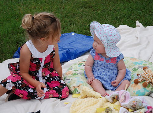 Two little ones enjoying the Living Earth Center Picnic held at OLGC on Saturday, August 25, 2018.