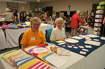 Sisters Anita Kolles and Evelyn Ulmen are ready for customers at the 2010 Craft Fair at OLGC.