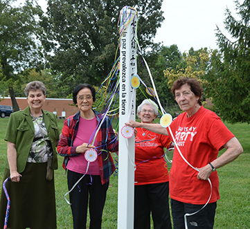 Sisters, staff and associates gathered around the Peace Pole to celebrate the International Day of Peace at Sancta Maria in Ripa in St. Louis.