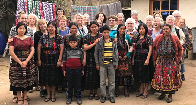 Rug hooking group at Glendy's home, the local leader of the rug hooking group in Guatemala.