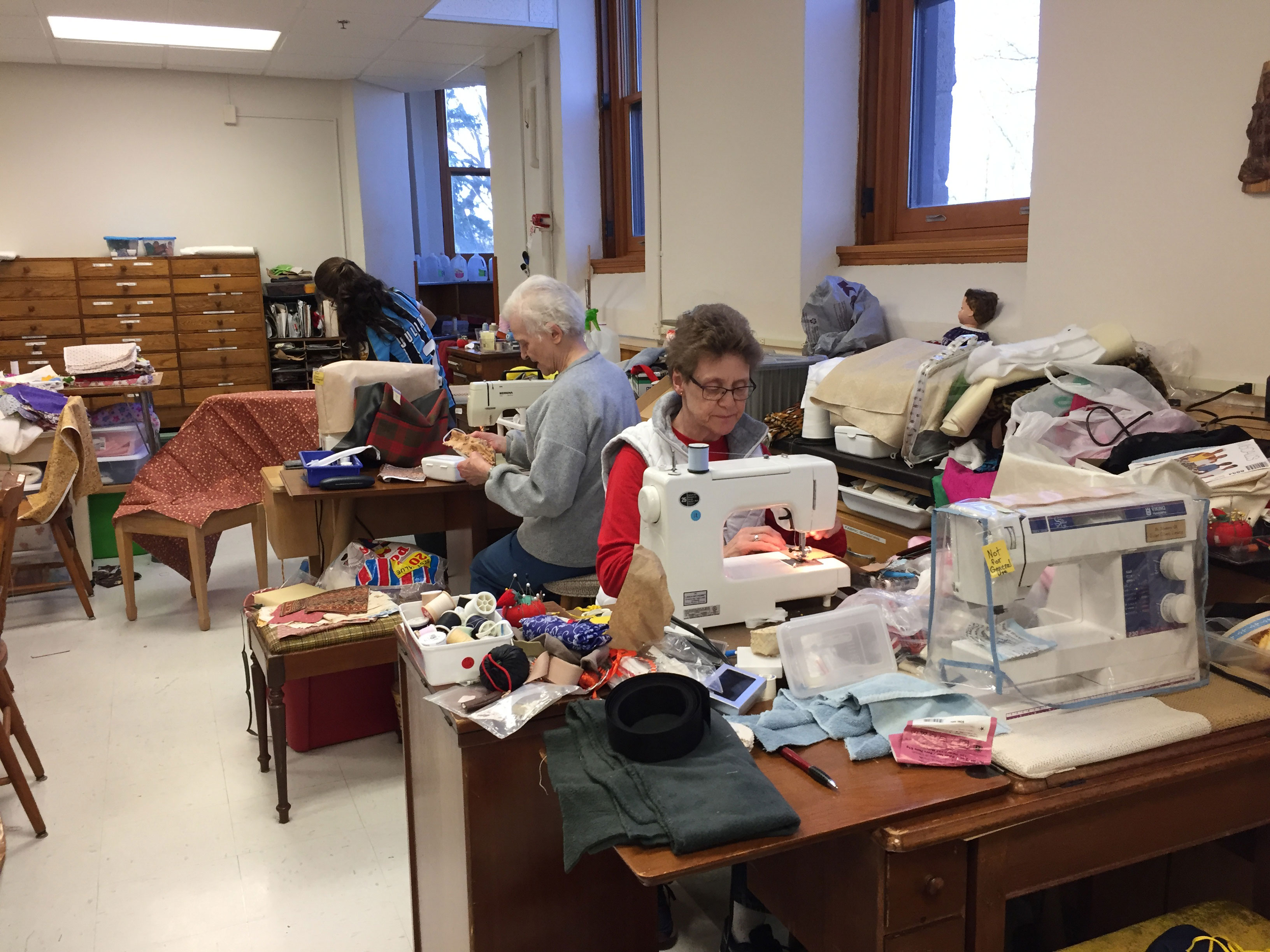 Sisters sew and iron fabric to make mask at Our Lady of Good Counsel in Mankato, Minnesota.