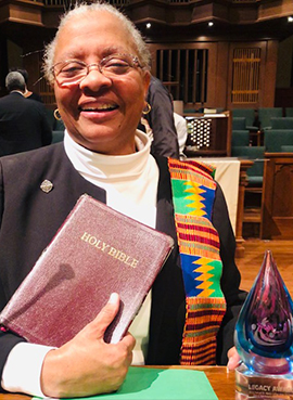 Sister Addie Lorraine Walker holds her Legacy Award from the 33rd Annual MLK Commission Inter-faith Worship Service award.