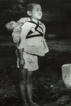 Joe O'Donnell's picture of the boy standing by the crematory taken in Nagasaki, Japan right after the bombs fell in 1945.