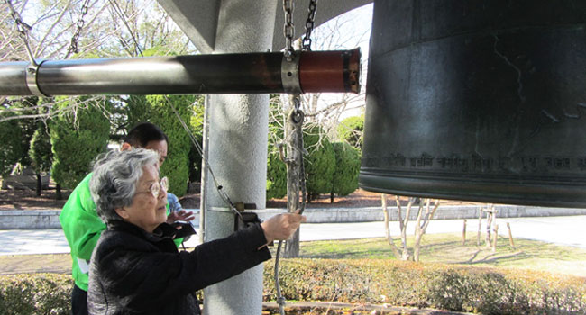 Sister Ruth Mori ringing the Bell of Peace located in Hiroshima Peace Memorial Park.  This park is located at site where the first atomic bomb exploded on August 6, 1945 and is dedicated to remembering the victims and promoting world peace.