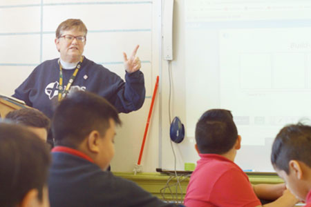 Sister Judy Fleisner teaching students in class at Notre Dame School of Milwaukee.