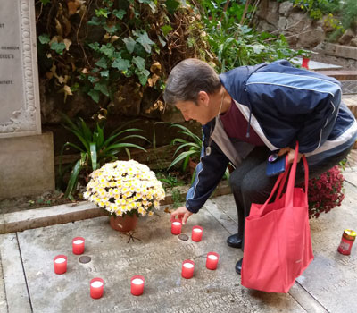 A photo of Sister Joan DiProspere lighting candles in Rome.