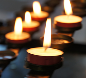 This photo is an image of candles burning. This article covers: Remembering Beloved Catholic Sisters - Catholic Extensions established nine grants in honor of the sisters who died from COVID-19-related complications at Elm Grove, Wisconsin. Each grant wil