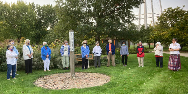 2020 Prayer for Peace. Sisters at OLGC gathered around the Peace Pole on the International Day of Prayer for Peace for a simple, socially-distanced, masked prayer service.
