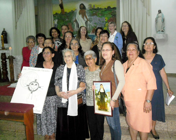 Sister Leetta Hammack works with associates in Paraguay.