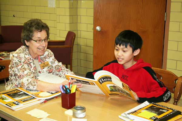 Sister Richarde and student work on their reading skills at the Good Counsel Learning Center on April 27, 2017.