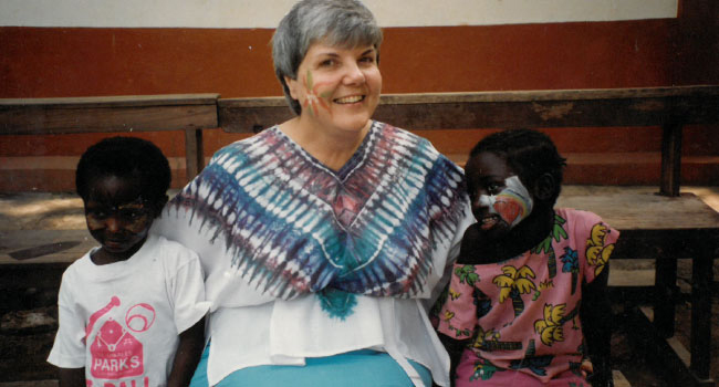 Sister Eleanor Ewerts with two students having fun in Sierra Leone.
