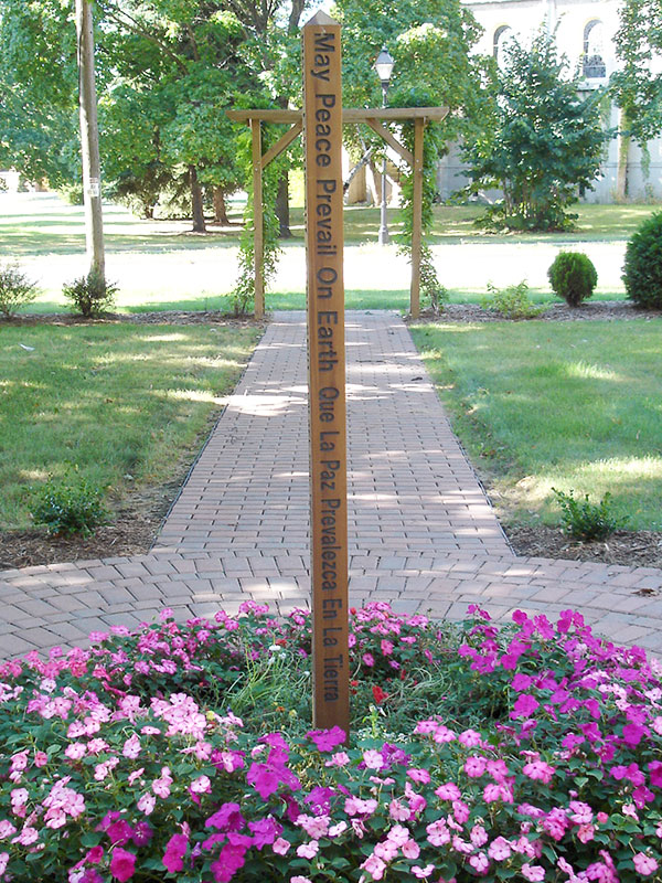The Peace Pole located at Notre Dame of Elm Grove in Elm Grove, Wisconsin.