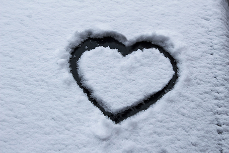 Heart shape etched into snow.